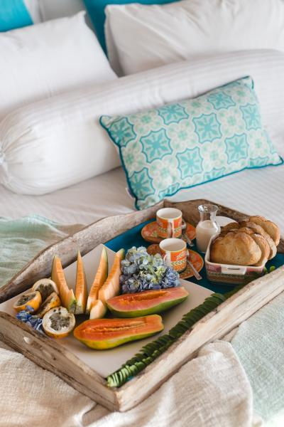 picture of a bed with a tray containing breakfast food on top